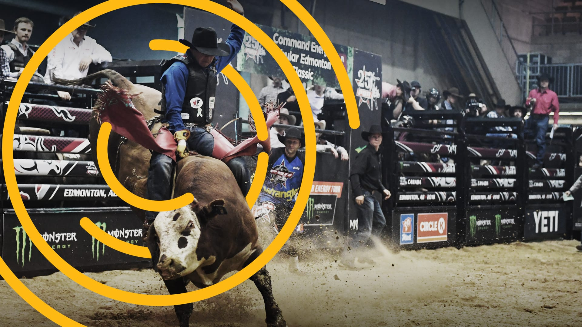 A-bull-rider-hangs-on-for-dear-life-amid-a-halo-of-excitemen